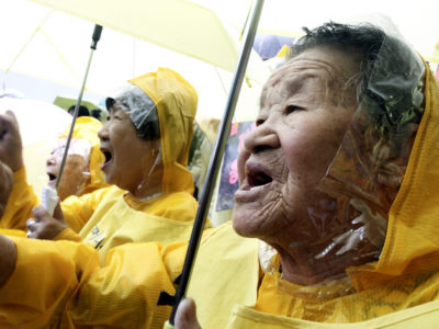 Former comfort women who served the Japanese Army as sexual slaves during World War II, shout a slogan in a rally before Korean Liberation Day of Aug. 15, which marks the end of Japanese colonial rule in 1945, in front of the Japanese Embassy in Seoul, South Korea, Wednesday, Aug. 12, 2009. They demanded from the Japanese government an official apology and financial compensation.(AP Photo/Ahn Young-joon)